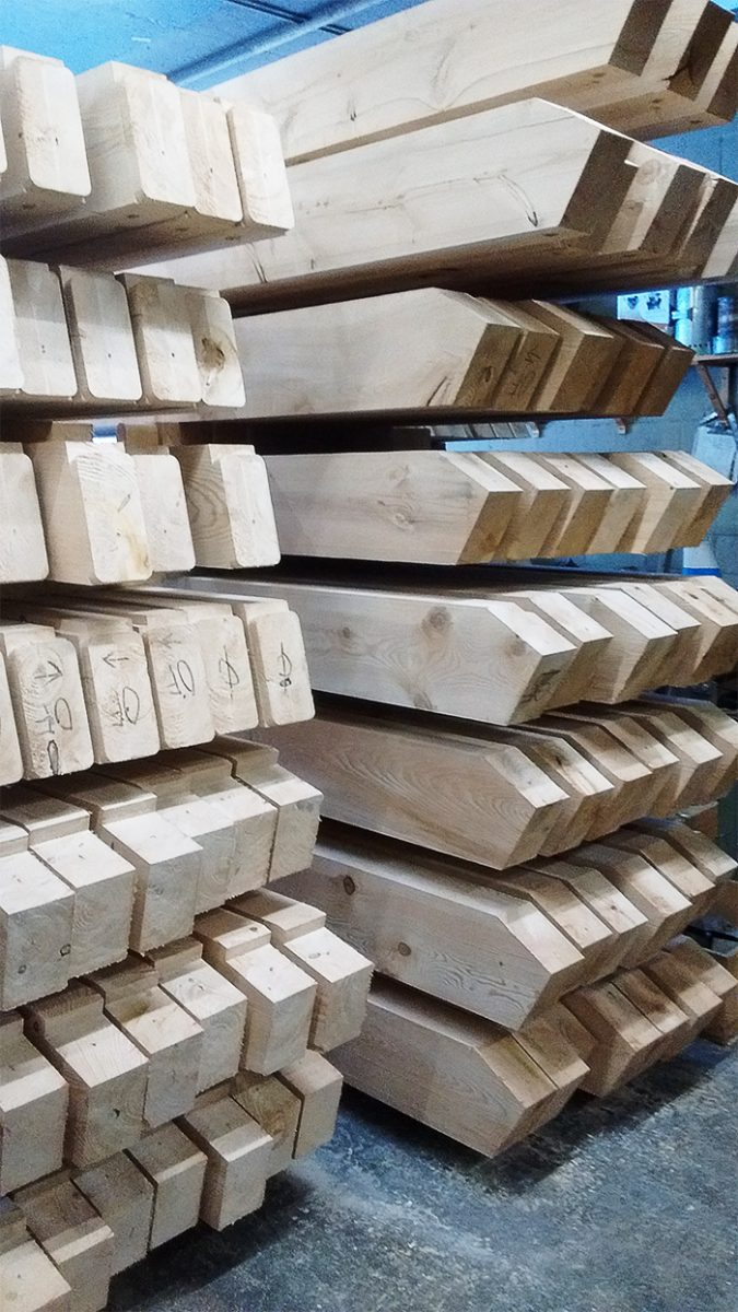 All the beams neatly stacked and numbered, ready to be assembled like a giant Tinker Toy!