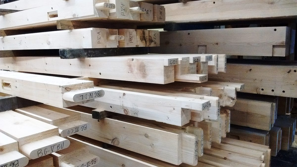 Every timber and beam is precisely trimmed and numbered for later assembly onsite.