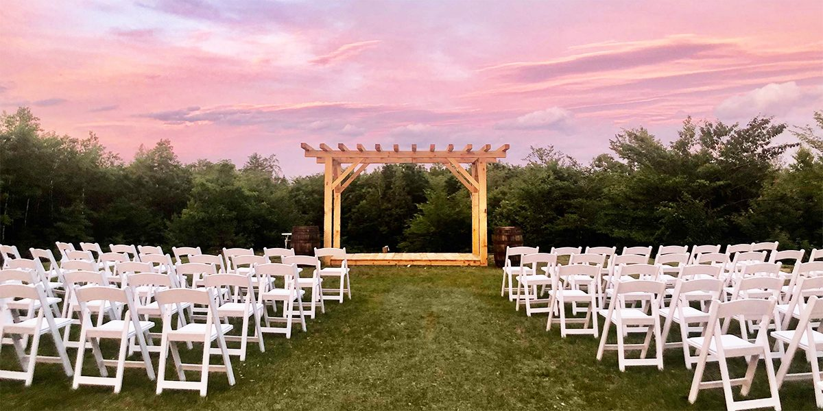 barn lights ceremony lawn with chairs