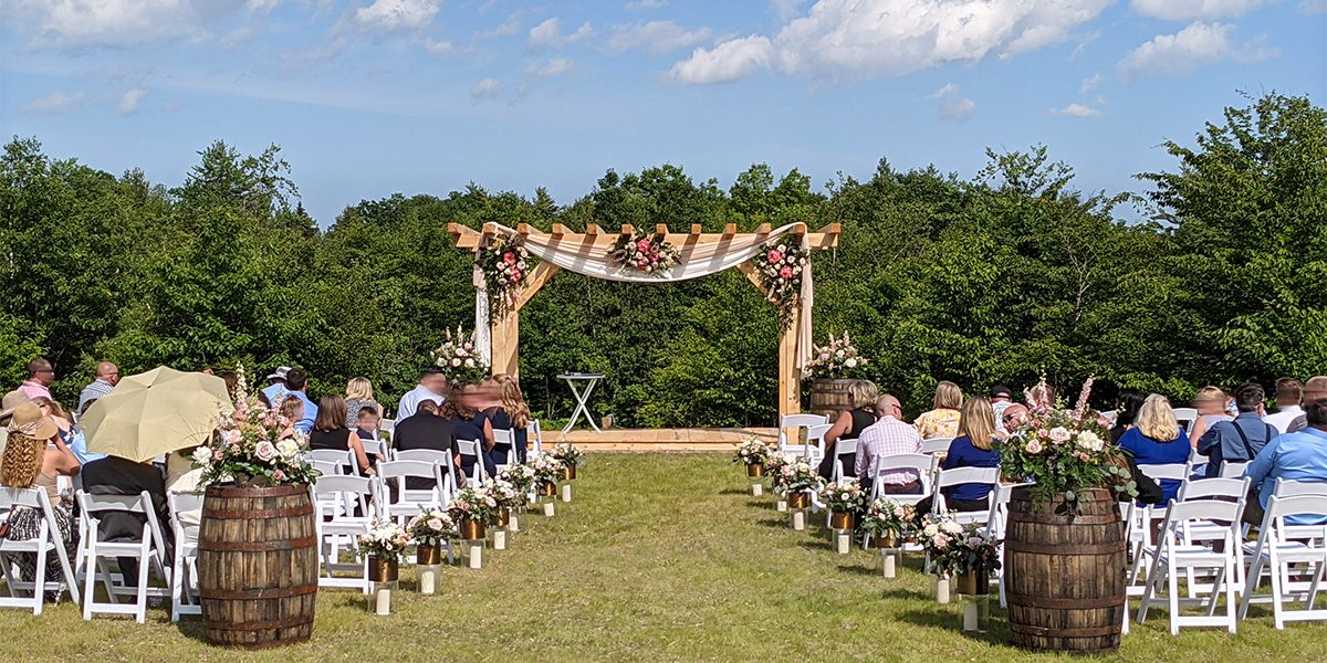 outdoor ceremony lawn at barn lights